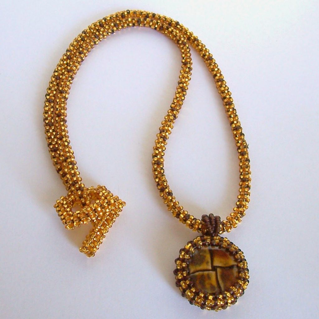 https://www.etsy.com/listing/129452494/gold-dust-beadwoven-necklace-with?ref=shop_home_active_7