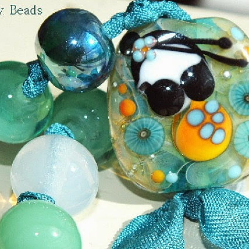 https://www.etsy.com/listing/189332319/handmade-lampwork-beads-turquoise?ref=favs_view_11
